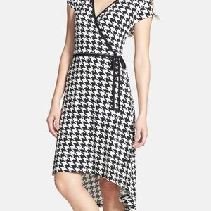 Houndstooth high-low faux wrap dress.
